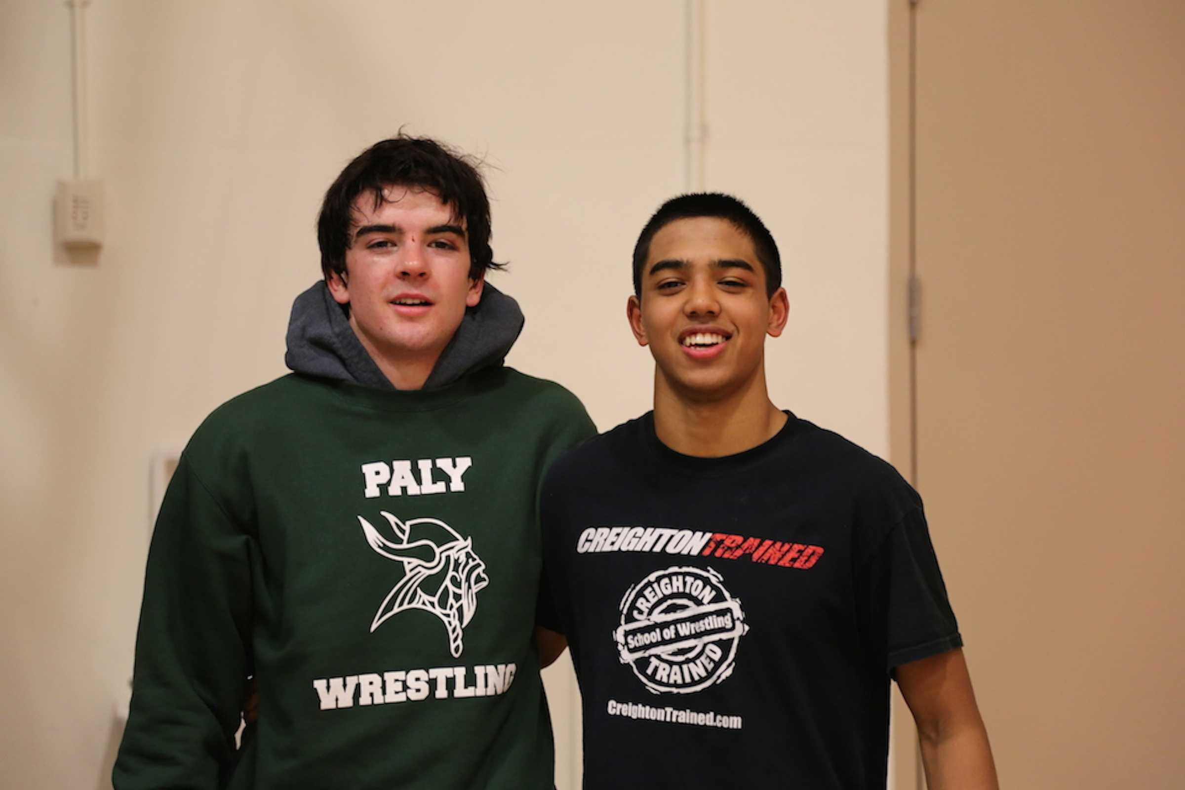 Paly wrestlers Seth Goyal ('17) and James Giaccia ('15) pose together after a meet.