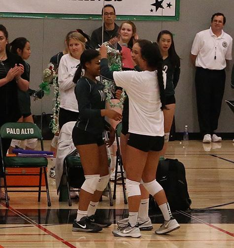 Gabrielle Bains (16) getting flowers from teammates