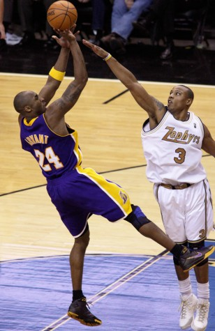 Bryant is shooting his signature shot over a defender.