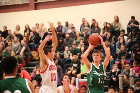Forward Max Dorward ('18) shoots a jumper over Gunn player.