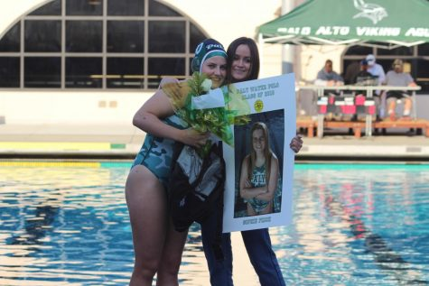 Sophie Frick (18') recieves flowers, bag and poster for Senior Night ceremony.