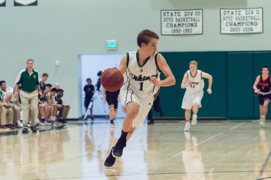 Boys basketball completes 12-0 league season by beating Cupertino 58-34 on senior night