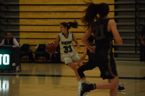 Alana Abeyta ('20) dribbles down the court.