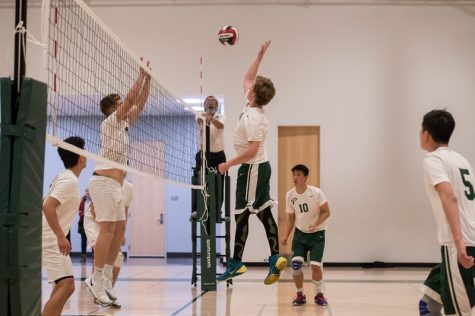 Bryce Doughman ('18) jumps for a spike.