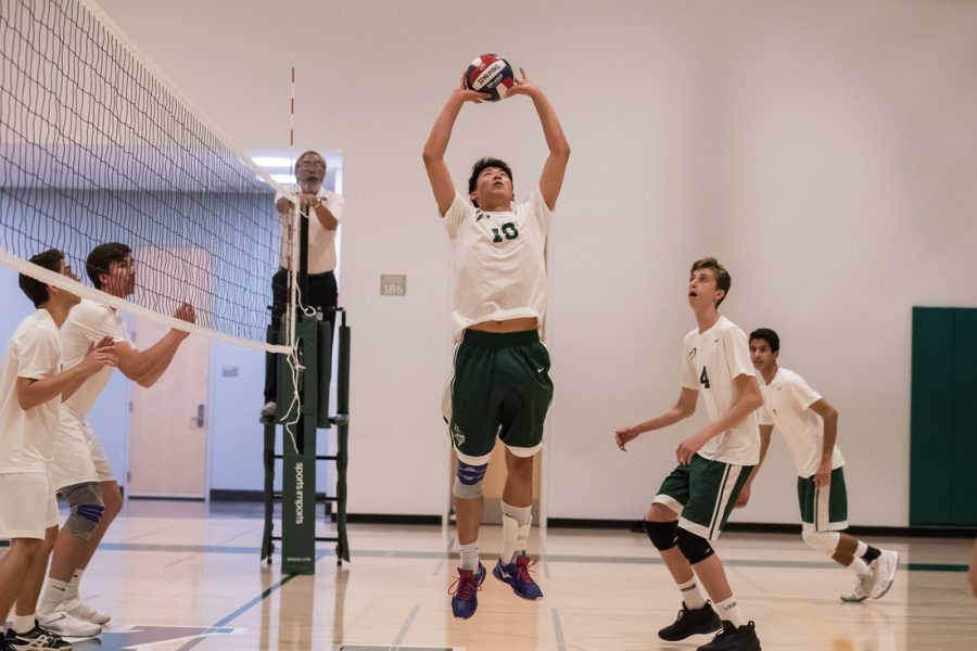Raymond Chen ('19) sets the ball for his teammate.