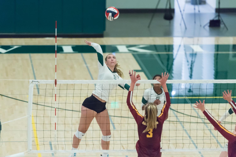Amelia Gibbs ('20) spikes the ball