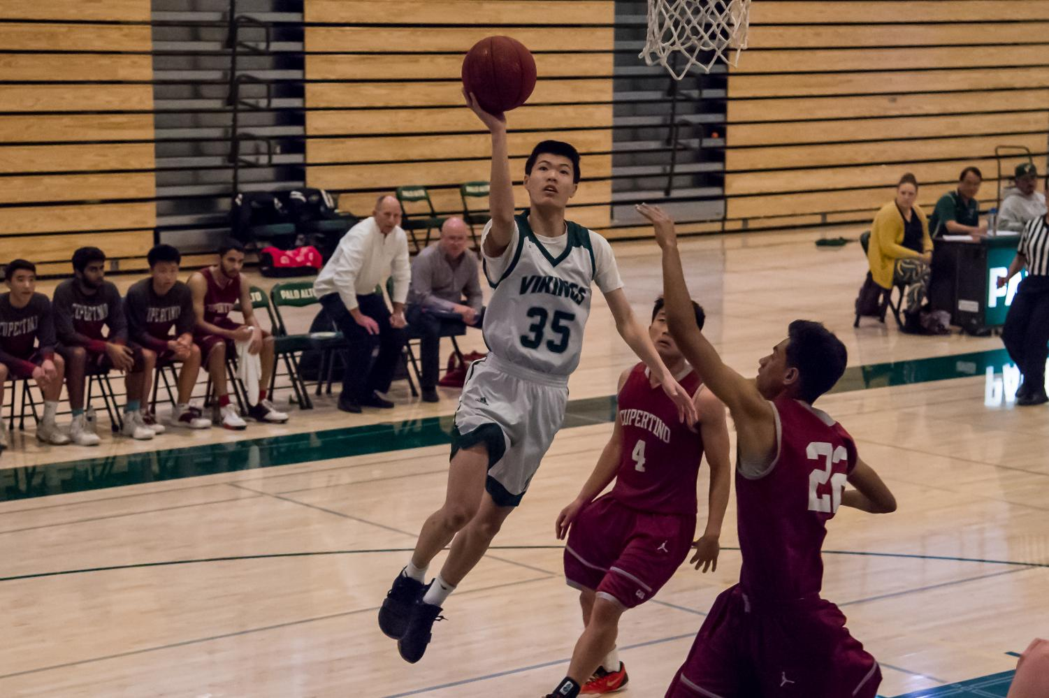 Marvin Zou ('19) elevates past defenders to lay the ball in.