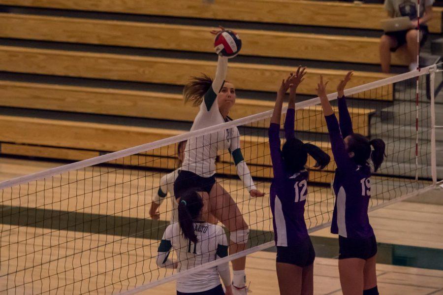 Amelia Gibbs ('20) hits over Monta Vista's unsuccessful block.
