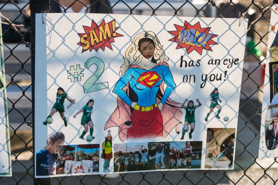As per senior night traditions, posters celebrating the senior girls decorated the fence.