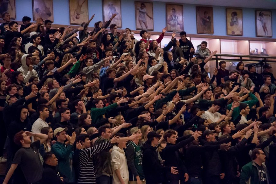 Fans jeer at a boys basketball game.