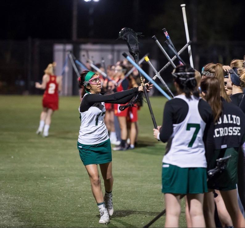 Sanaz Ebrahimi shows her camaraderie with her lacrosse teammates.