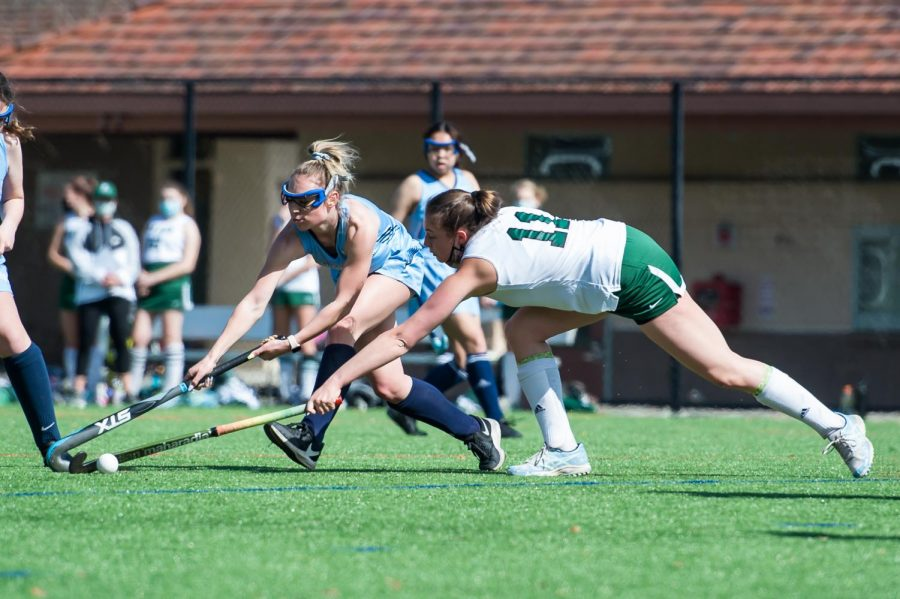 Lexi Gwyn ('21) lunges to the ball.